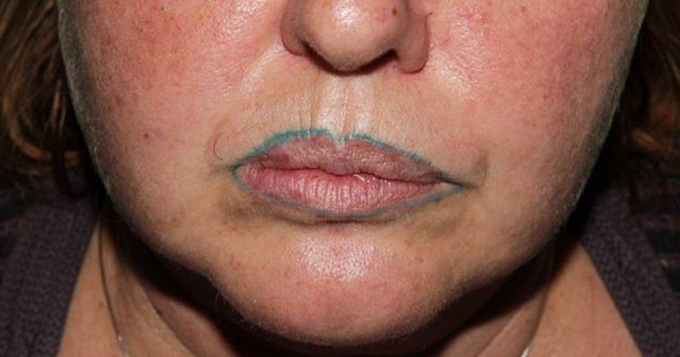 Facial lips tattoo
